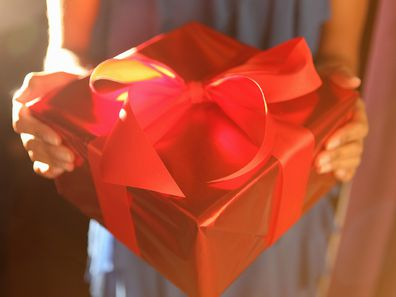Wife giving husband gift for Valentine's Day