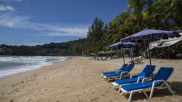 Empty lounge chairs seen on an empty Kamala Beach in Phuket, Thailand.