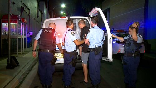 Police arrest one of two men taken from the scene at Burwood.