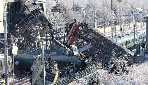 A high-speed train hit a railway engine and crashed into a pedestrian overpass at a station in the Turkish capital of Ankara, killing nine people and injuring dozens.