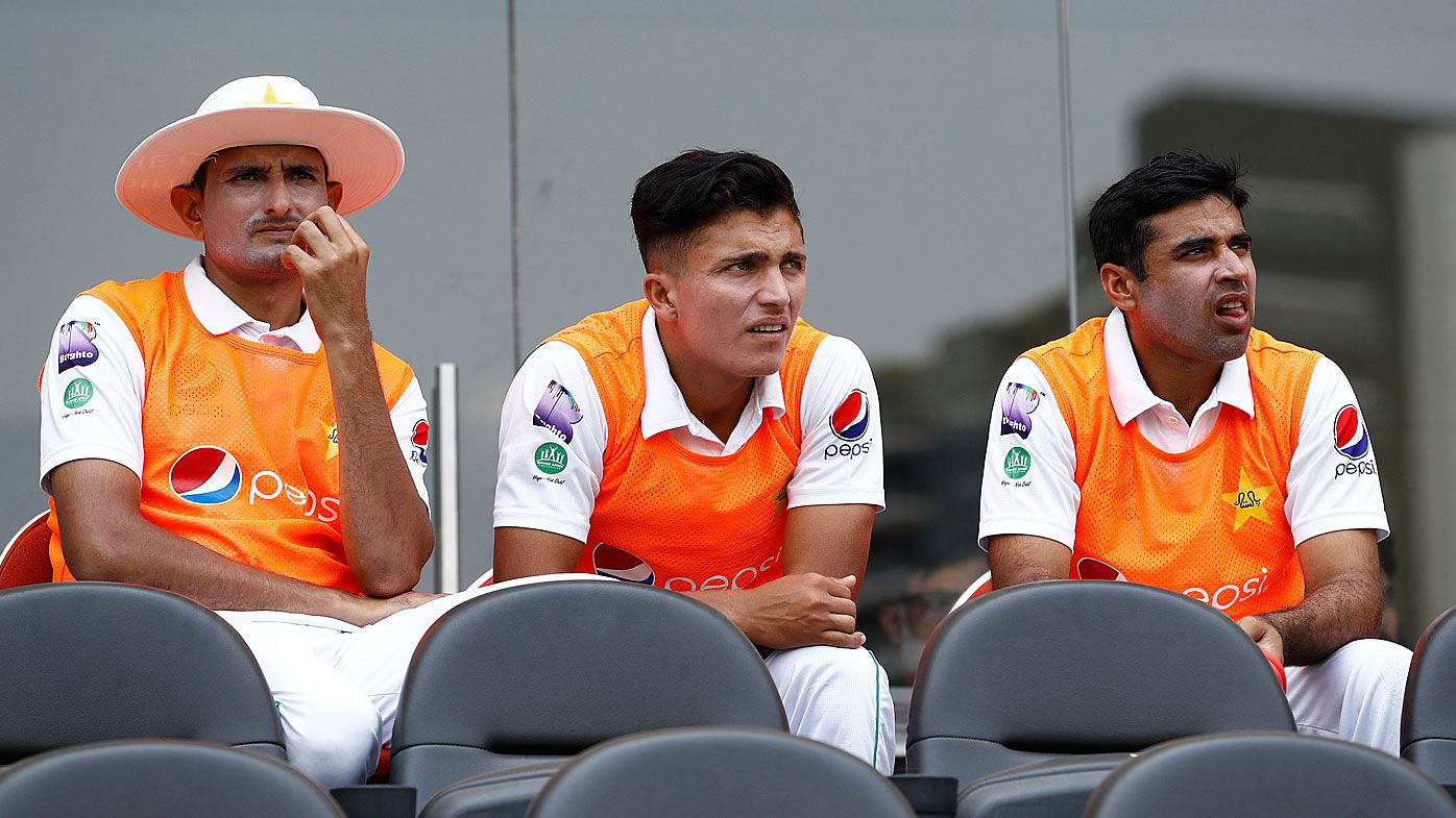 Mohammad Abbas (L) of Pakistan looks on after being left out of Pakistan's XI