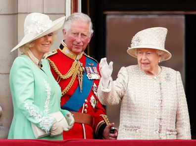 Camilla, Prince Charles, and the Queen watch a flypast from the balcony of Buckingham Palace during Trooping The Colour in 2019.