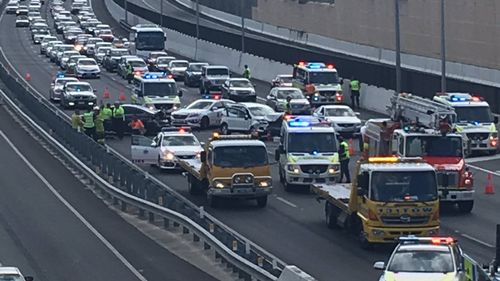Two police officers have been injured after a serious crash on the Pacific Highway. (9NEWS)
