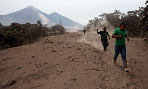 Residents living around the Fuego volcano inspect the damage done by the eruption. Picture: AAP