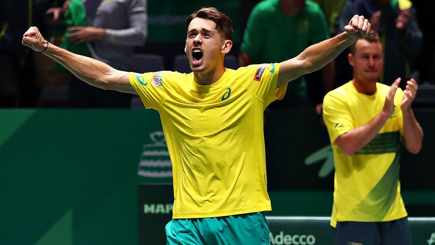 Alex De Minaur of Australia celebrates winning his match in his quarter final singles match against Denis Shapovalov