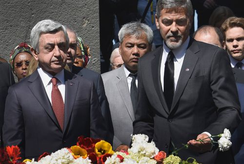 George Clooney and Armenian President Serzh Sarkisian lay flowers at the Genocide Memorial. (AFP)