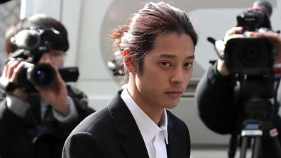 South Korean singer Jung Joon-Young is seen arriving at a Seoul police station on March 14, 2019.