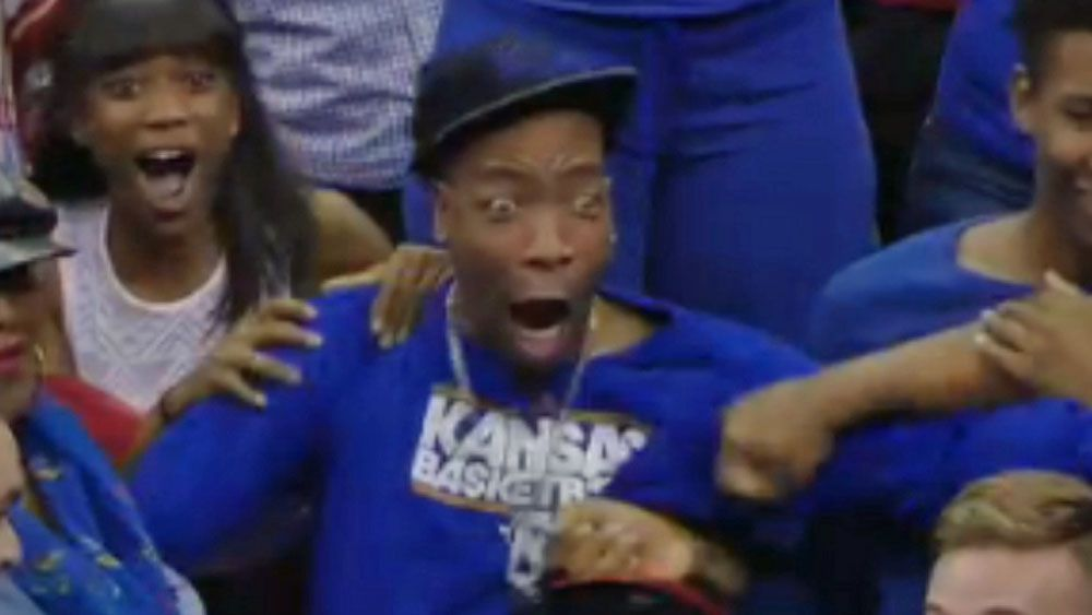 Fan loses his mind over nephew's monster dunk