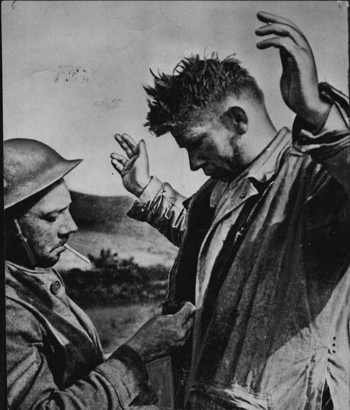 A German soldier is taken prisoner in North Africa.