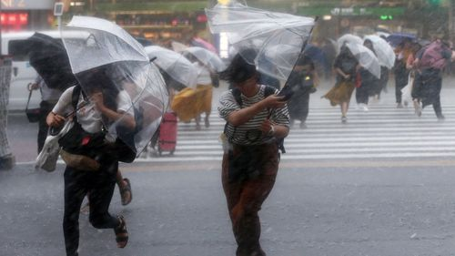 Heavy rain fell on parts of Japan as an approaching typhoon threatened to dump more rain on a region devastated by floods and landslides (AAP)
