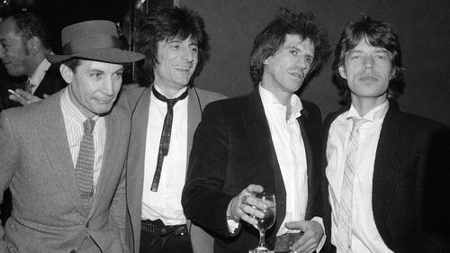 """Members of the Rolling Stones, from left, Charlie Watts, Ron Wood, Keith Richards, and Mick Jagger appear at a party celebrating the opening of their film """"Let's Spend The Night Together,"""" in New York on Jan. 18, 1983."""