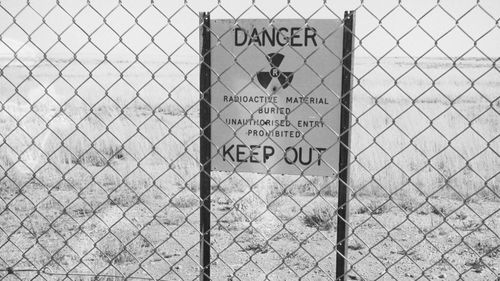Photo of a radioactive warning sign Maralinga village in South Australia in 1952. (AAP)