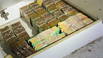 Over $370,000, drugs, drug-related paraphernalia and an air rifle also being found in the Gold Coast searches.