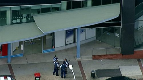 Man arrested after credit union office is locked down by police in Sydney's west
