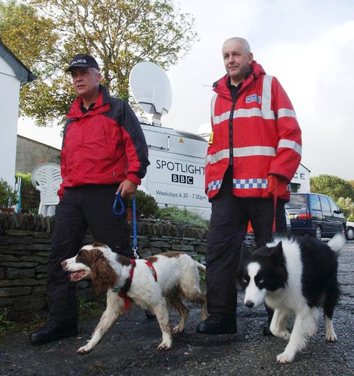 South Yorkshire Police dog handler Martin Grime with dog Eddie (left) in the North Cornwall village of Boscastle conducting a sweep search for possible victims of the 2004 flood which swept through the village.
