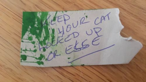 This threatening note was found attached to the cat's neck.