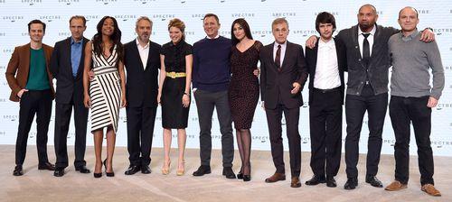 James Bond returns: (L to R) Andrew Scott, Ralph Fiennes, Naomie Harris, director Sam Mendes, Lea Seydoux, Daniel Craig, Monica Bellucci, Christoph Waltz, Ben Whishaw, Dave Bautista and Rory Kinnear. (Getty)