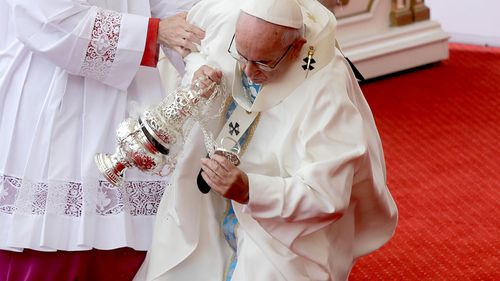 The pontiff stumbled on an altar step. (AAP)