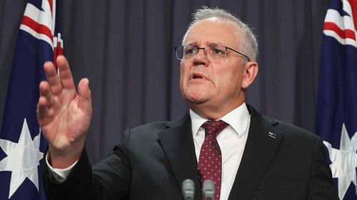 Scott Morrison challenges a reporter at a press conference.
