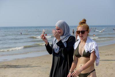 People cool down at the beach during the heatwave hitting Europe in Bloemendaal Aan Zee seaside resort, Netherlands.