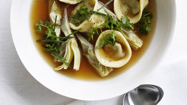 Chicken brodo with artichoke tortellini and spring herbs