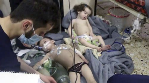 Young children were among the people being treated in the aftermath of the suspected attack. Picture: AAP.