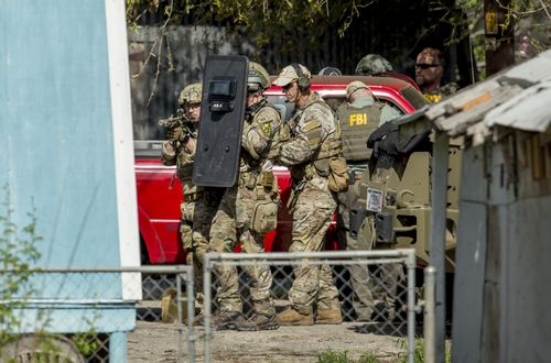 Heavily armed tactical police officers have swooped on Mark Anthony Conditt's home in Pflugerville, Texas. (AAP)
