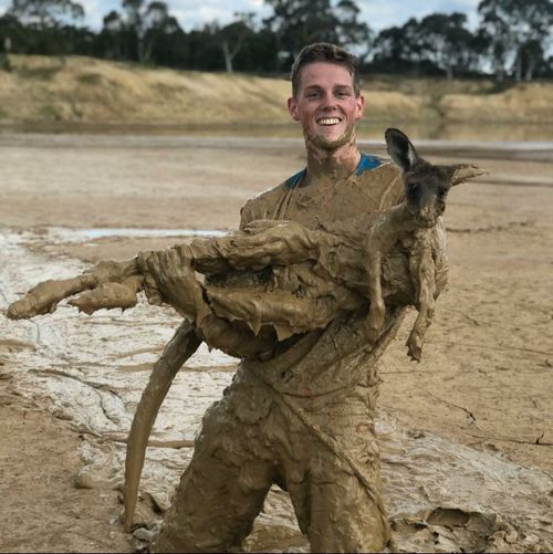Nick Heath, 19, with the muddy roo. (Supplied)