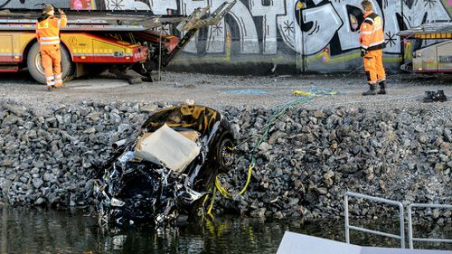 The vehicle they were travelling in plunged more than 25m off a bridge into a canal. (AAP)