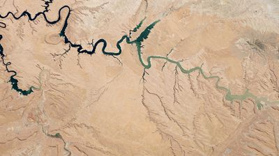 A reservoir of the Colorado River, Lake Powell stretches across the border between Utah and Arizona. Since the turn of the century it has suffered from drought and at the time this picture was taken last May, was more than half empty.