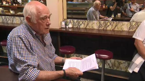 Just minutes before opening, co-owner of Pellegrini's, Nino Pangrazio, read a short statement to his staff.