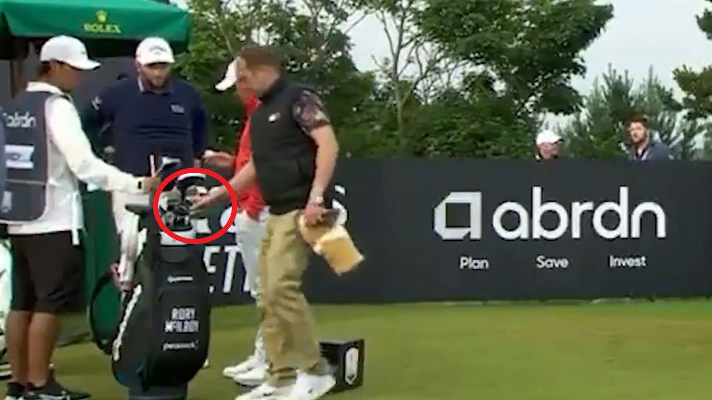 A spectator takes one of Rory McIlroy's clubs at the Scottish Open.