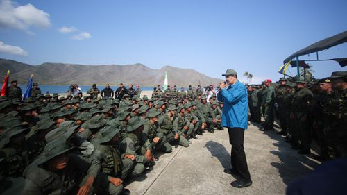 Venezuelan President Nicolas Maduro speaks to members of the military, in Turiamo, Venezuela, where he asked troops to take care of the 'union' and 'loyalty' to the National Amerd Forces.