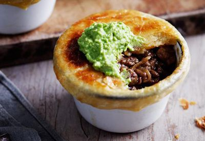 """Recipe: <a href=""""/recipes/ibeef/9034928/little-beef-and-onion-pot-pies-with-mushy-peas"""" target=""""_top"""">Little beef and onion pot pies</a>"""