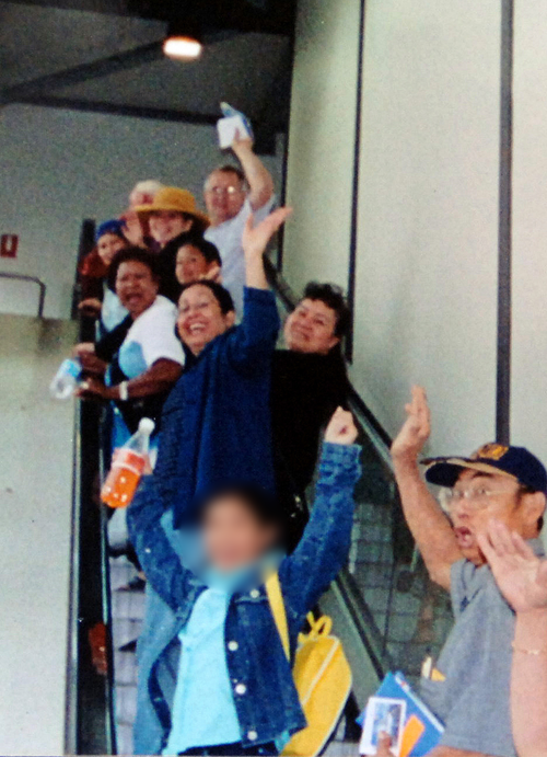 The last photo taken of the Brisbane mother (waving, centre, blue top) as she leaves for the cruise holiday. (AAP)