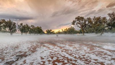 <p>Residents of the remote Northern Territory town of Alice Springs were shocked to see its iconic red dirt coated in white hailstones, after storms hit after 4pm yesterday.</p> <p>(Caama Alice Springs / Steve Strike)</p>