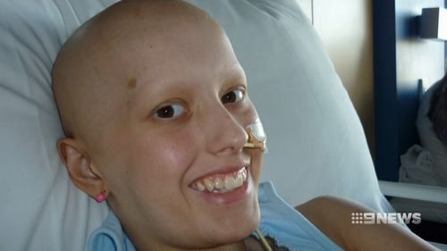 Permanently losing her hair barely scratches the surface of what Ms O'Kane deals with day-to-day. (9NEWS)