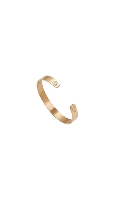 "<a href=""http://jenniferfisherjewelry.com/fine-jewelry/wrist/skinny-reverse-burnish-white-diamond-cuff-with-double-initials"" target=""_blank"">Skinny Reverse Burnish White diamond Cuff with Double Initials, approx. $4,006, Jennifer Fisher</a><br>"