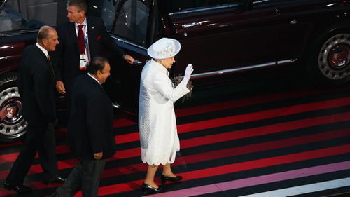 Queen Elizabeth II, Patron of the CGF waves as she walks with Prince Imran the CGF President during the Opening Ceremony for the Glasgow 2014 Commonwealth Games. (Getty)