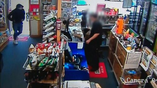 The hooded man stormed the Pagewood newsagency about 5:40pm last night.
