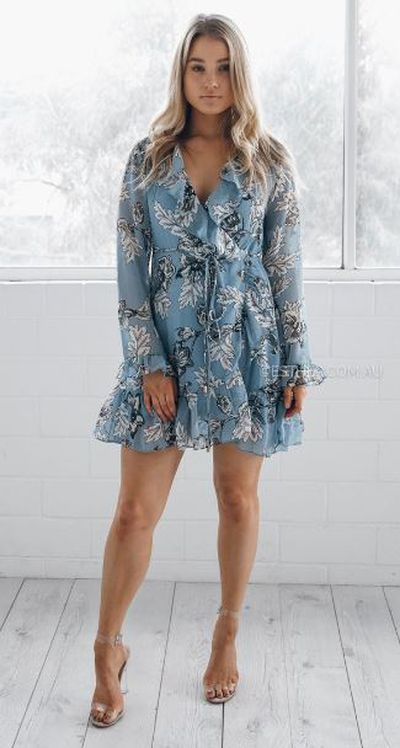 "<a href=""https://www.esther.com.au/products/sera-frill-long-sleeve-dress-blue"" target=""_blank"">Esther Sera Frill Long Sleeve Dress, $69.95.</a>"