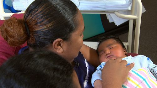 Despite carrying such a heavy baby, mum Teu  is delighted her newborn is doing well. (9NEWS)