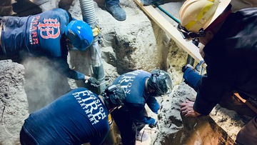 An image released by the City of Mission, Texas, shows rescuers working to free the boy from the well.