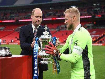Following the match, William handed the trophy to Leicester City's Kasper Schmeichel