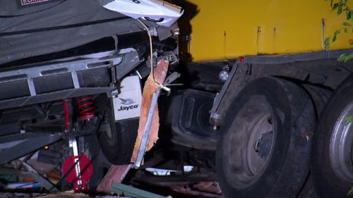 The garbage truck remained at the scene overnight. (9NEWS)