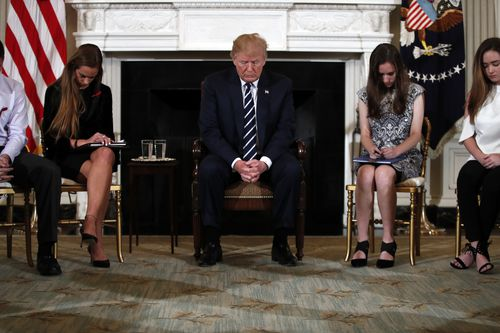 Mr Trump was surrounded by students who survived the shooting in Parkland, Florida. (AAP)