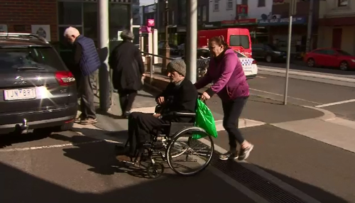 The wheelchair-bound grandfather has broken down in tears, recalling the moment he was viciously bashed during a random mugging.