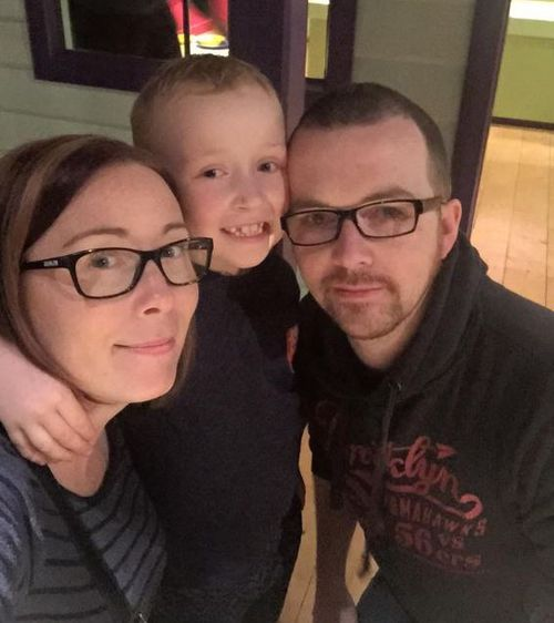Jack, age eight, with his mum and dad.