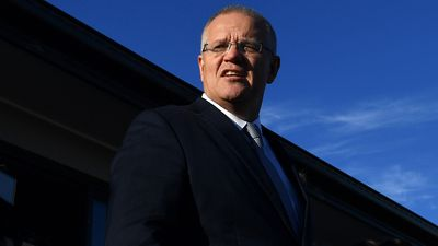 Prime Minister Scott Morrison at a housing construction site at Orchard Hills in Sydney.