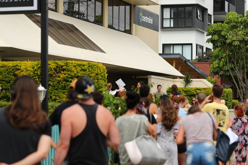 People queue outside Centrelink in Pam Beach on March 23, 2020 in Various Cities, Australia.